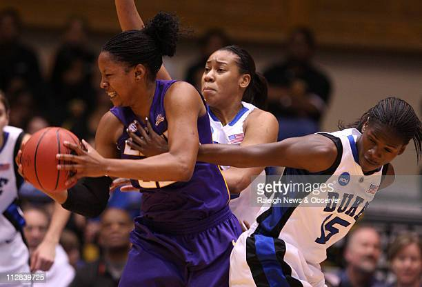 Duke's Bridgette Mitchell and Joy Cheek pressure LSU's Courtney Jones during firsthalf action in the second round of the 2010 NCAA Women's Basketball...