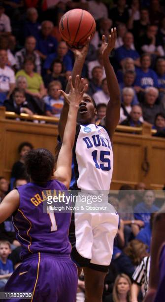 Duke's Bridgette Mitchell shoots over the defense of LSU's Katherine Graham during firsthalf action Duke defeated LSU 6052 in the second round of the...