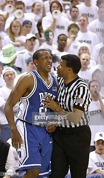 Duke's Chris Duhon gets consolation from a referee after being poked in the eye by a Spartan Duke won the game 7250