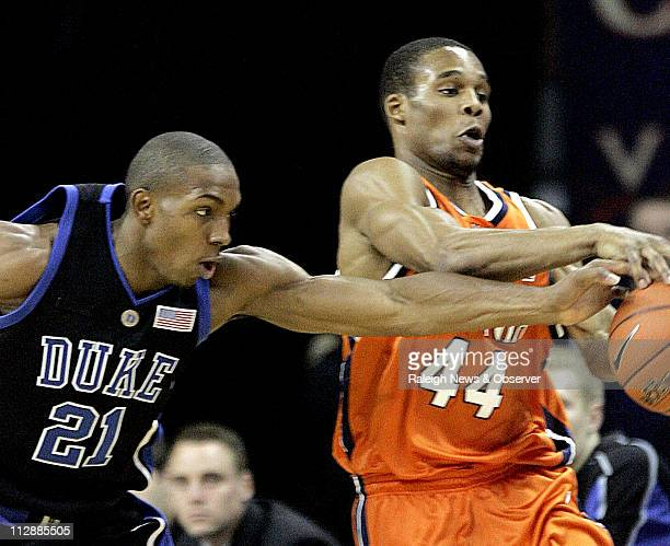 Duke's DeMarcus Nelson challenges Virginia's Sean Singletary to a loose ball during the first half at John Paul Jones Arena in Charlottesville...
