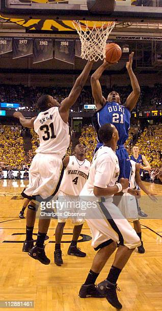 Duke's DeMarcus Nelson goes up against Wake Forest's Jamie Skeen and other Wake defenders during the first half at Lawrence Joel Veterans Memorial...