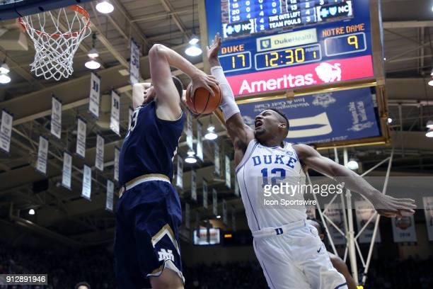 Duke's Javin DeLaurier blocks a shot by Notre Dame's Martinas Geben The Duke University Blue Devils hosted the University of Notre Dame Fighting...