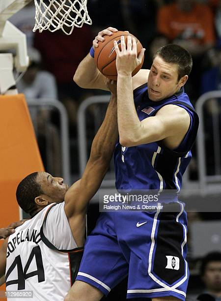 Duke's Josh McRoberts grabs a rebound from Miami's Keaton Copeland during the first half at Bank United Center in Coral Gables Florida Sunday January...