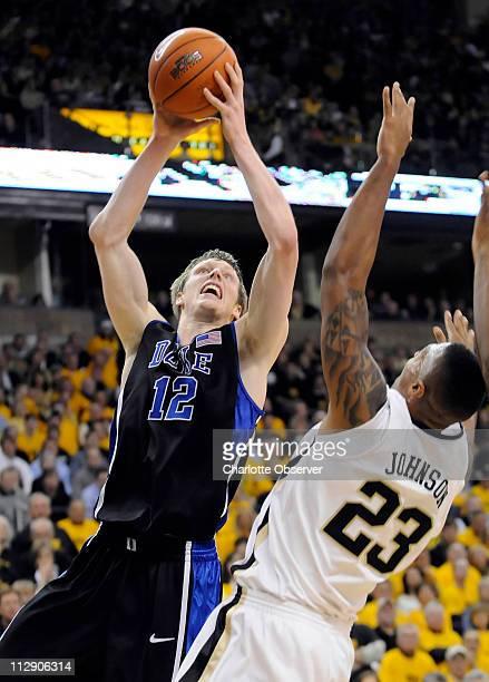 Duke's Kyle Singler goes in past Wake Forest's James Johnson during game action at Lawrence Joel Coliseum in WinstonSalem North Carolina Wednesday...