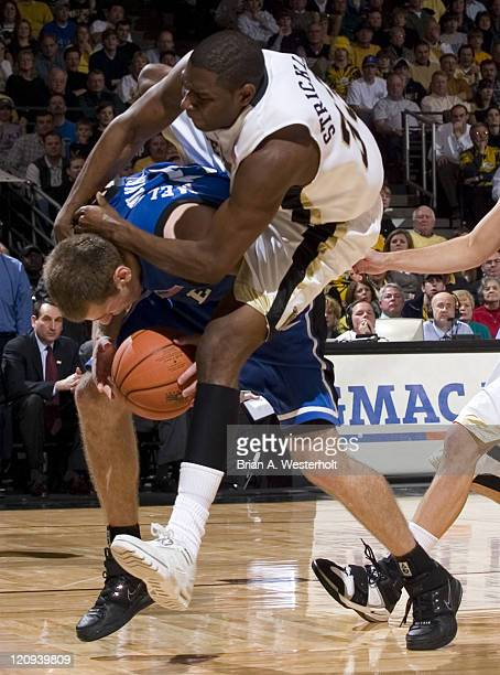 Duke's lee Melchionni is fouled hard by Wake Forest's Trent Strickland during second half action at the LJVM Coliseum in WinstonSalem NC Sunday...