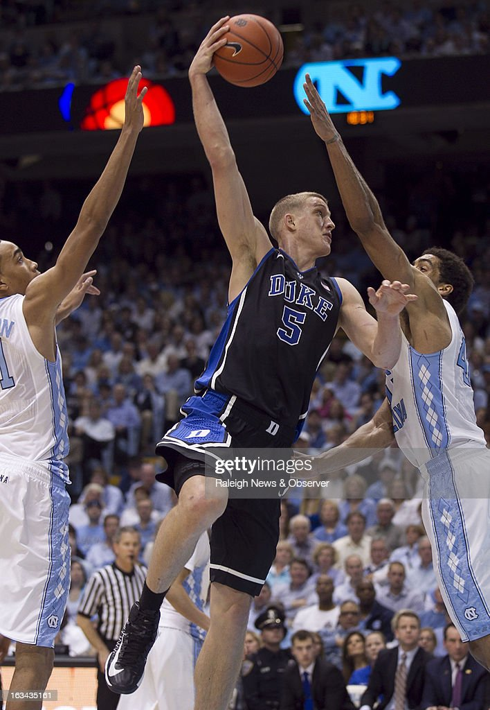 Duke's Mason Plumlee (5) puts up a hook shot over North Carolina's James Michael McAdoo in the second half on Saturday, March 9, 2013, at the Smith Center in Chapel Hill, North Carolina. Duke topped the Tar Heels, 69-53.