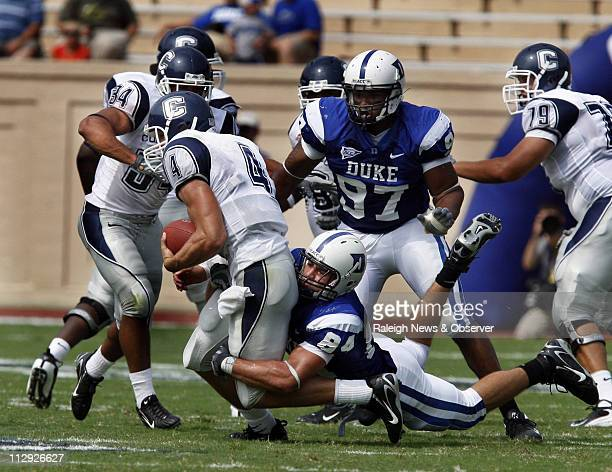 Duke's Patrick Bailey sacks Connecticut quarterback Tyler Lorenzen during the first half Connecticut defeated Duke 4514 at Wallace Wade Stadium in...