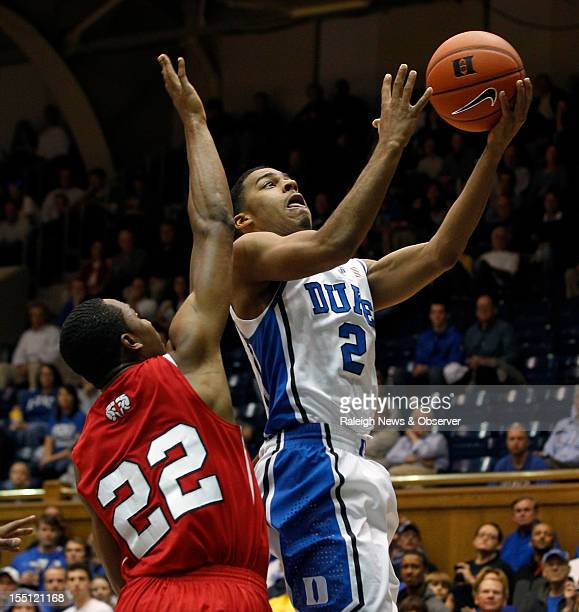 Duke's Quinn Cook goes to score over WinstonSalem State's WyKevin Bazemore in the first half at Cameron Indoor Stadium in Durham North Carolina on...