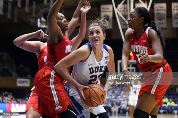 Duke's Rebecca Greenwell is guarded by Ohio State's Sierra Calhoun and Stephanie Mavunga during the Duke Blue Devils game versus the Ohio State...
