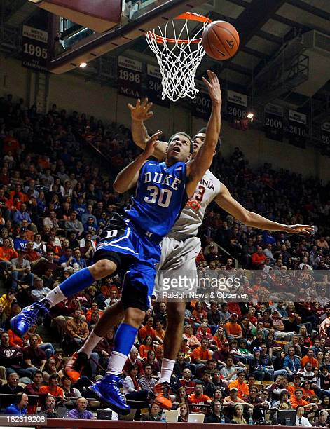 Duke's Seth Curry is fouled by Virginia Tech's Marshall Wood in the second half at Cassell Coliseum in Blacksburg Virginia on Thursday February 21...