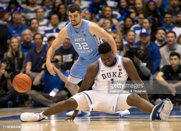 Duke's Zion Williamson falls to the court under North Carolina's Luke Maye injuring himself and damaging his shoe during the opening moments of the...