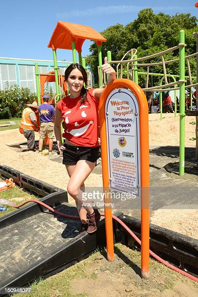 Dulce Maria joins Lynwood community along with KoolAid Kaboom to Build kiddesigned playground on August 29 2012 in Los Angeles California