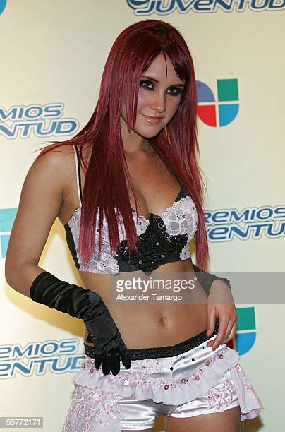 Dulce Maria of the band RBD poses in the press room at the 2nd Annual Premios Juventud Awards at the University of Miami Convocation Center September...