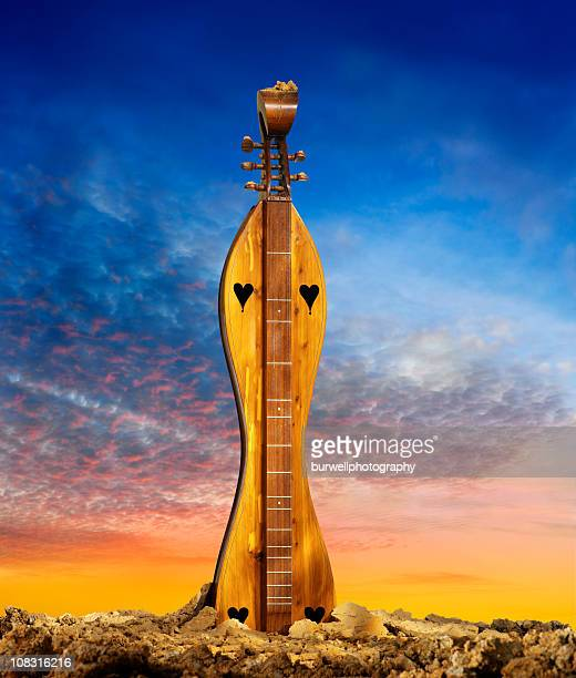dulcimer growing out of the earth - musical instrument string stock photos and pictures