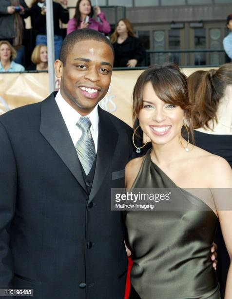 Dule Hill and Nicole Lyn during The 10th Annual Screen Actors Guild Awards Red Carpet Arrivals at The Shrine Auditorium in Los Angeles California...