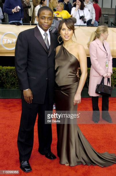 Dule Hill and wife Nicole Lyn during The 10th Annual Screen Actors Guild Awards Arrivals at The Shrine Auditorium in Los Angeles California United...