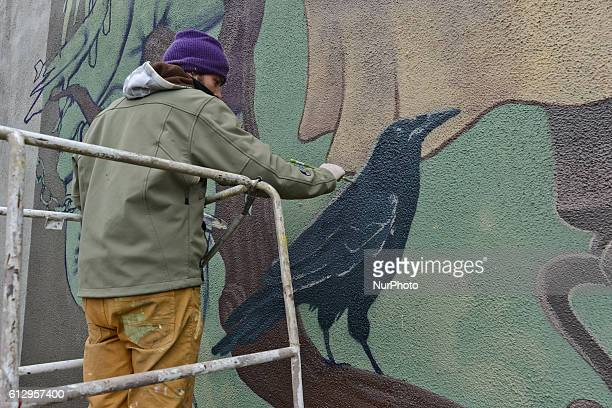Dulk a Spanish street artists is working on his new Art Street project in Krakow at Mogilskie Roundabout Many passers by stop for a time to admire...