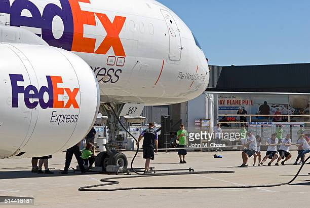 dulles day plane pull - cargo airplane stock photos and pictures