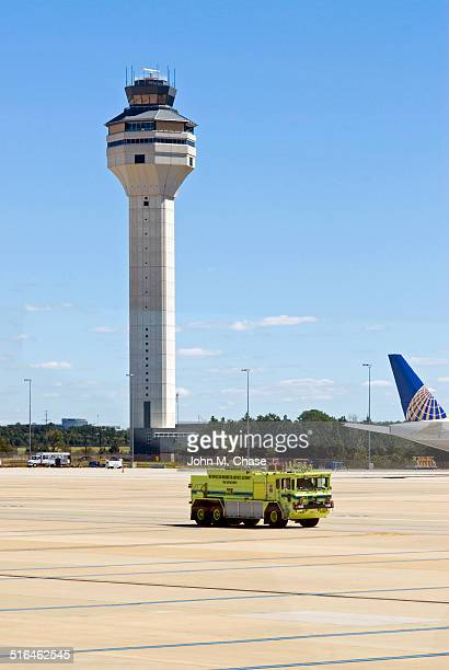 dulles international airport control tower and fire truck - international firefighters day stock pictures, royalty-free photos & images