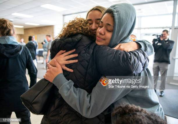 Duluth Marshall's girl's basketball forward Daisa Starks embraced her mother Amy and one of her teammates after returning to school Friday afternoon...