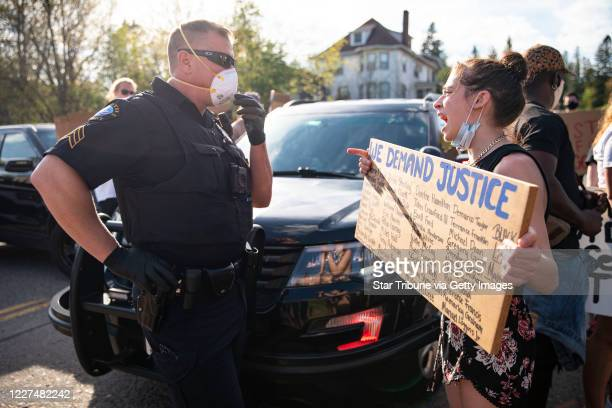 Brayleigh Keliin held a sign with dozens of names of black people who died from police force in front of Sgt Tony Radloff of the Duluth Police...