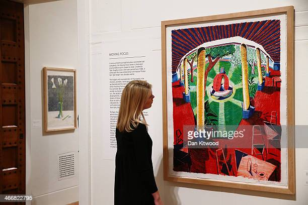 Dulwich Picture Gallery employee poses besides a piece of work entitled 'Views of Hotel Well III by British artist David Hockney during a press...