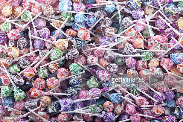 dum dumb lolly pops - lollipop stock pictures, royalty-free photos & images