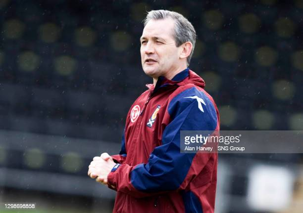 Scotland manager George Burley looks relaxed despite growing injury problems