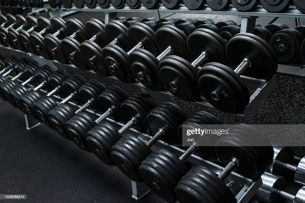 Dumbbells in gym : Stock Photo