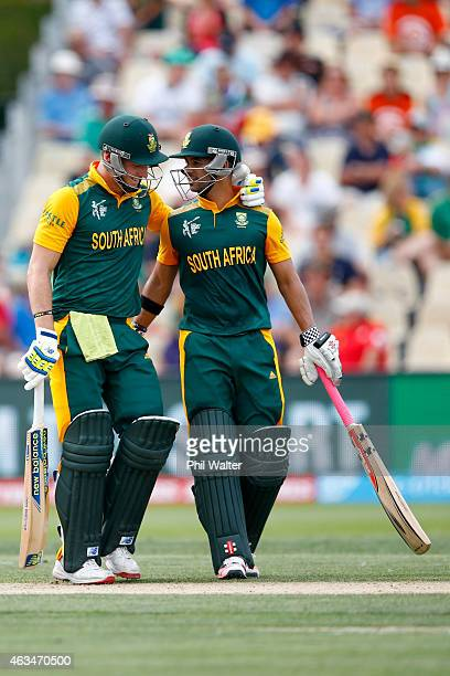 Duminy and David Miller of South Africa celebrate during the 2015 ICC Cricket World Cup match between South Africa and Zimbabwe at Seddon Park on...