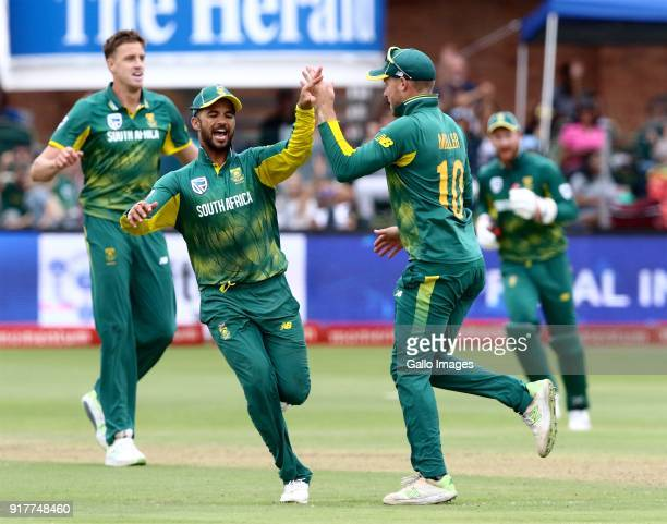 Duminy and David Miller of South Africa celebrate the taking of Virat Kohli of India's wicket during the 5th Momentum ODI match between South Africa...