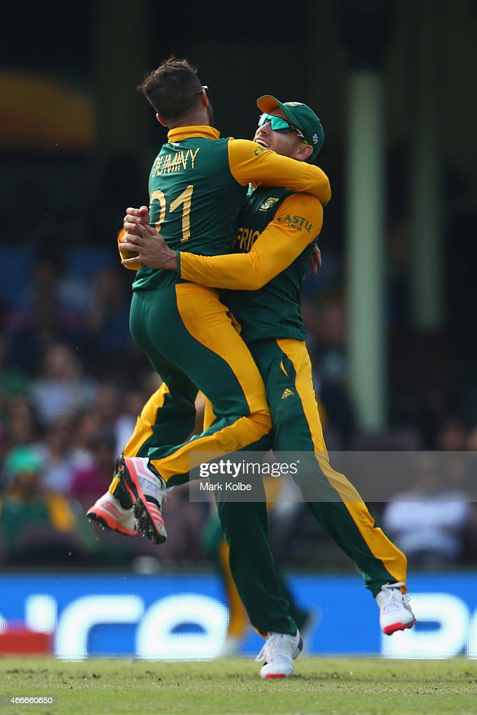 JP Duminy and Faf du Plessis of South Africa celebrates combining to take the wicket of Angelo Mathews of Sri Lanka during the 2015 ICC Cricket World Cup match between South Africa and Sri Lanka at Sydney Cricket Ground on March 18, 2015 in Sydney, Australia.