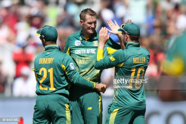 Duminy of South Africa and David Miller of South Africa congratulate Chris Morris of South Africa for getting Hardik Pandya of India wicket during...