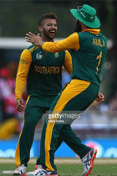 Duminy of South Africa celebrates taking a hat trick with Hashim Amla of South Africa the 2015 ICC Cricket World Cup match between South Africa and...