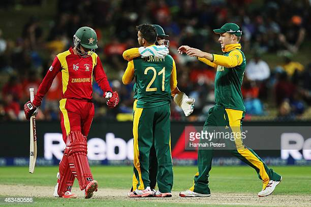 Duminy of South Africa celebrates the wicket of Sean Williams of Zimbabwe during the 2015 ICC Cricket World Cup match between South Africa and...