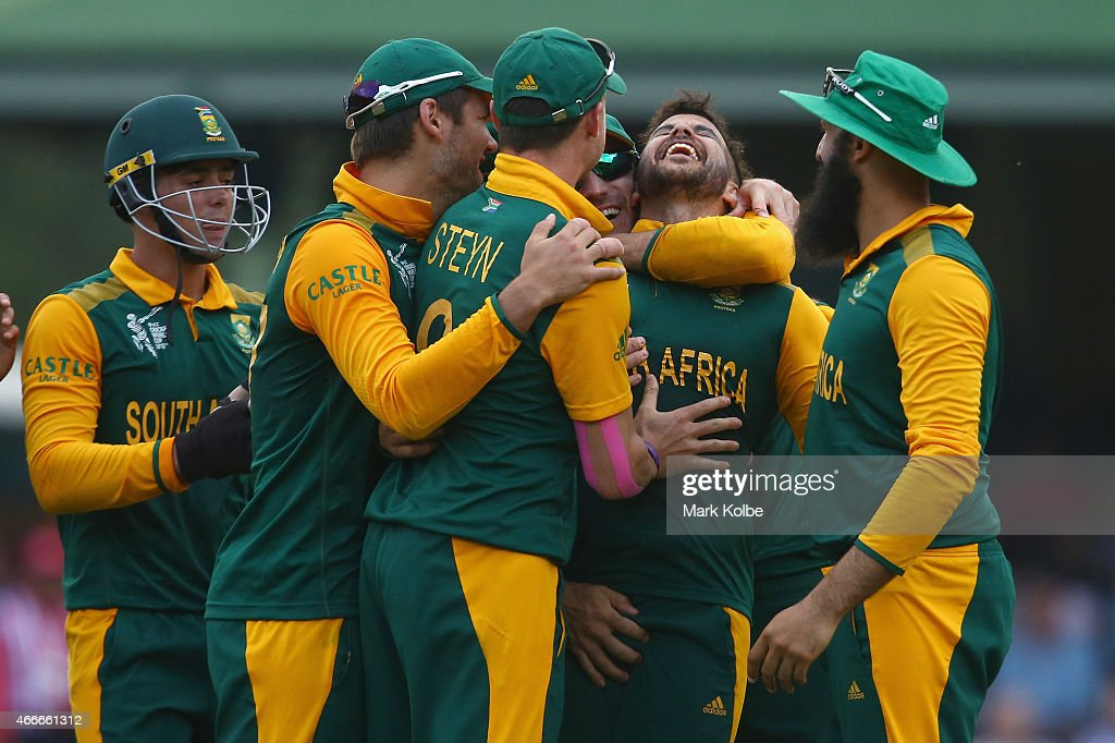 JP Duminy of South Africa celebrates with his team mates after taking the wicket of Tharindu Kaushal of Sri Lanka during the 2015 ICC Cricket World Cup match between South Africa and Sri Lanka at Sydney Cricket Ground on March 18, 2015 in Sydney, Australia.