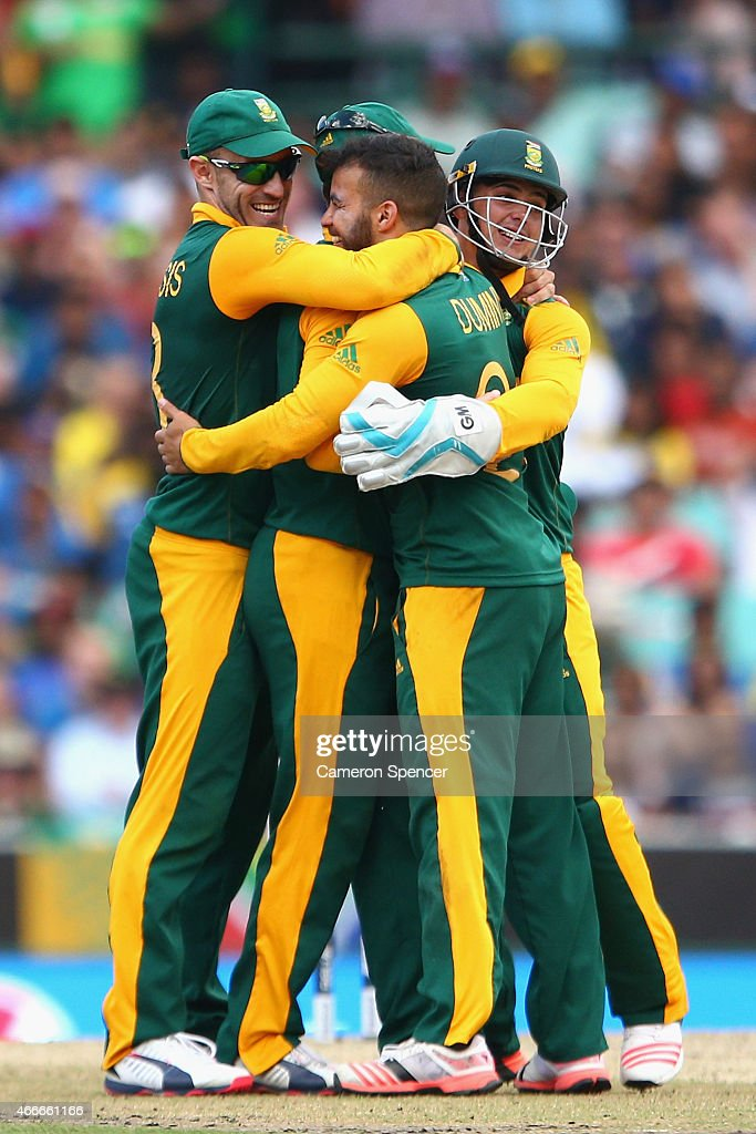 JP Duminy of South Africa celebrates with team mates after dismissing Nuwan Kulasekara of Sri Lanka during the 2015 ICC Cricket World Cup match between South Africa and Sri Lanka at Sydney Cricket Ground on March 18, 2015 in Sydney, Australia.