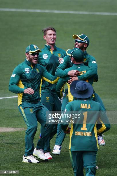 Duminy of South Africa celebrates with teammates for the wicket of Mitchell Santner of New Zealand during game five of the One Day International...