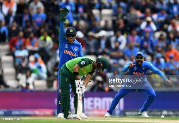 Duminy of South Africa reacts as he is LBW to Kuldeep Yadav of India as MS Dhoni of India appeals during the Group Stage match of the ICC Cricket...