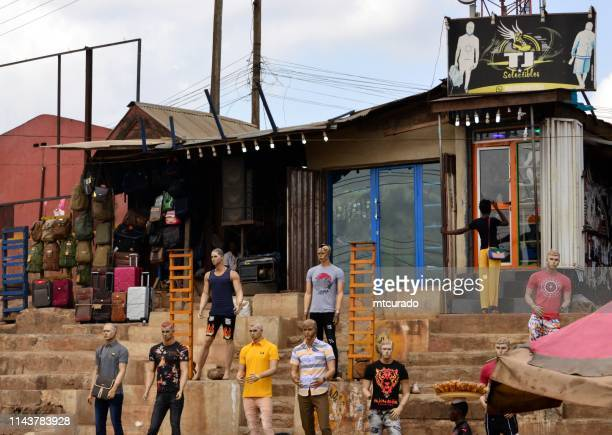 dummies on the street - shop front - ibadan, oyo state, nigeria - akinfenwa stock pictures, royalty-free photos & images