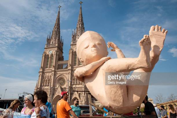 A dummy of a fetus is carried by catholic antiabortion supporters during a mass called by the Argentine Catholic Church in rejection of a bill...