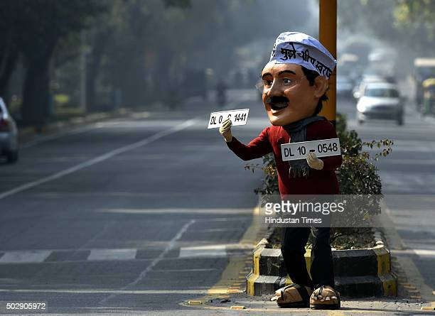 A dummy of Delhi CM Arvind Kejriwal is seen on the road promoting oddeven campaign on December 30 2015 at Ferozshah Road in New Delhi India The...