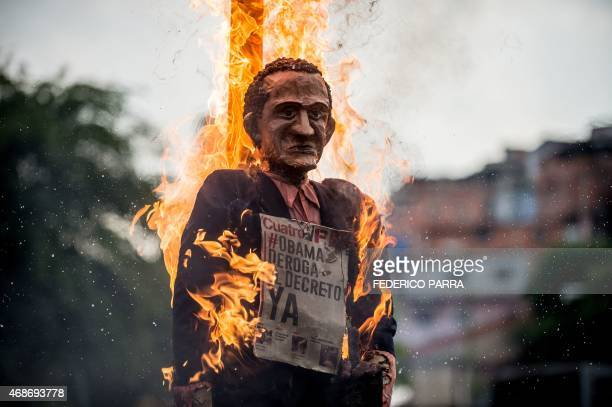 A dummy of US President Barack Obama reading 'Obama abolish the decree now' is burnt as the 'Burning of Judas' during an Easter celebration at El...
