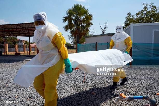 A dummy patient is carried by members of UNICEF medical staff during a training session on the infection prevention of the Ebola virus in Juba South...
