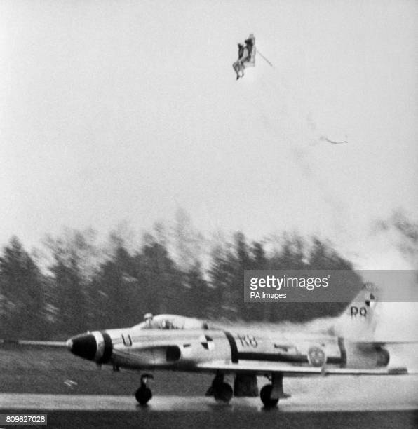 A dummy shoots skywards from a Swedish fighter aircraft equipped with a new experimental form of rocket propelled ejector seat So powerful is the...