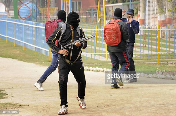 Dummy terrorists wearing masks holding AK47 riffles entering the school premises during the mock drill by Anti Terror Squad Provincial Armed...