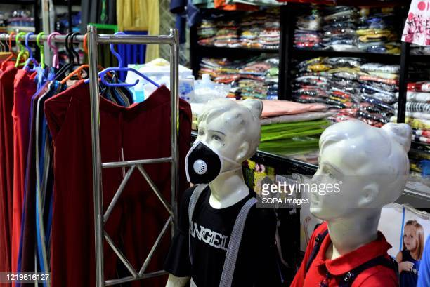 Dummy wearing a face mask at an open stall in a shopping mall during the eased restrictions. Lockdown in Bangladesh has eased, renowned shopping...