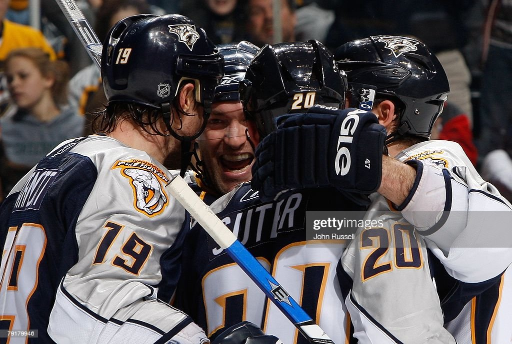 J.P. Dumont #71 celebrates a goal with Jason Arnott #19, Ryan Suter #20 and Ville Koistinen #4 of the Nashville Predators against the St. Louis Blues on January 21, 2008 at the Sommet Center in Nashville, Tennessee.