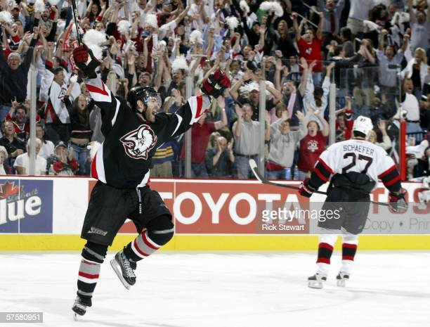 P Dumont of the Buffalo Sabres celebrates scoring the gamewinning goal at 1455 of the first overtime period to defeat the Ottawa Senators 32 in game...