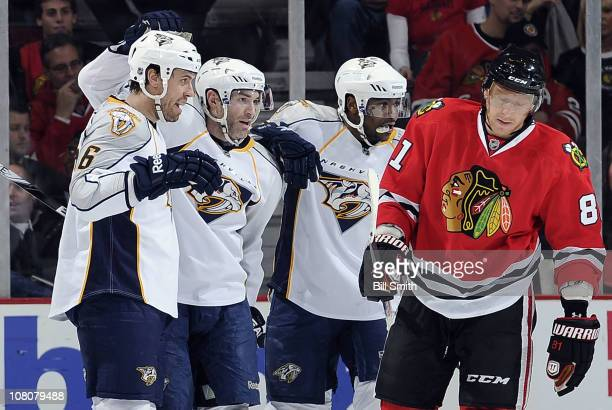 Dumont of the Nashville Predators celebrates in between teammates Shea Weber and Joel Ward after scoring against the Chicago Blackhawks as Marian...
